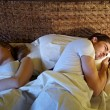 Young couple sleeping in bed — Stok fotoğraf