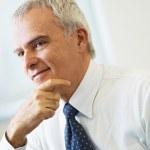 Mature businessman thinking — Stock Photo
