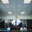 Businessman doing yoga in office — Stock Photo #9304662
