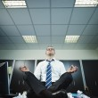 Businessman doing yoga in office — Stock Photo #9304663