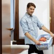 Man doing chores with washing machine — Foto de Stock