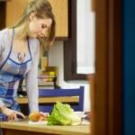 Woman preparing fresh salad at home — Stock Photo