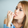 Worried woman biting her nails — Stock Photo