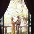 Old man and woman dancing outdoor -  