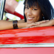 Beautiful woman in cabriolet car — Stockfoto