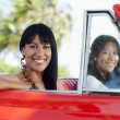 Beautiful twin sisters in cabriolet car — Stock Photo #9305911