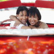 Beautiful twin sisters hugging in cabriolet car — Stock Photo