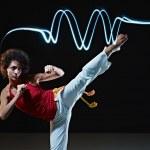 Hispanic woman playing capoeira martial art — Stock Photo