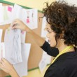 Woman with sketches in fashion design studio - Stock Photo