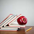 Red apple on books — Stock Photo