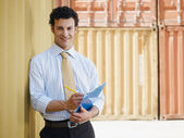 Business man with shipping containers — Stock Photo