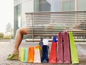 Woman sleeping on bench — Stock Photo