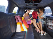 Women shopping in limousine — Stock Photo
