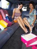 Women shopping in limousine — Stock Photo