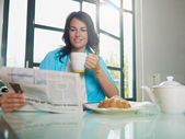 Woman having breakfast at home — Stock Photo