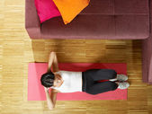 Woman doing abs exercise at home — Stock Photo