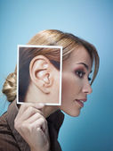 Businesswoman with big ears — Stockfoto