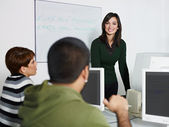 Teacher and students in college — Stock Photo