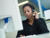 Woman working in call center — Stok fotoğraf