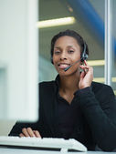 Woman working in call center — Stock Photo