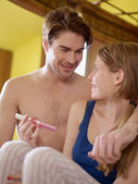 Young couple with pregnancy test kit — Stock Photo