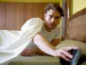 Young adult man waking up in the morning — Stock Photo