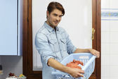 Man doing chores and washing clothes — Stock Photo