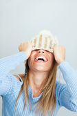 Woman covering face with hat — Stock Photo