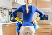 Woman doing housekeeping — Stock Photo
