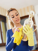 Woman polishing silverware — Stock Photo