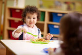 Children eating lunch in kindergarten — Stock Photo