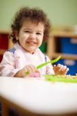 Little girl eating lunch in kindergarten — Stock Photo