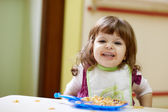 Little girl having lunch at kindergarten — Stock Photo