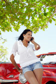 Beautiful woman on the phone near cabriolet car — Stock Photo