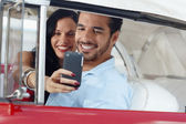 Taking souvenir picture with mobile telephone — Stock Photo