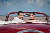 Man and beautiful woman hugging in cabriolet car — Stock Photo