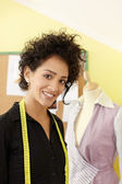 Woman working with sketches in fashion design studio — Stock Photo