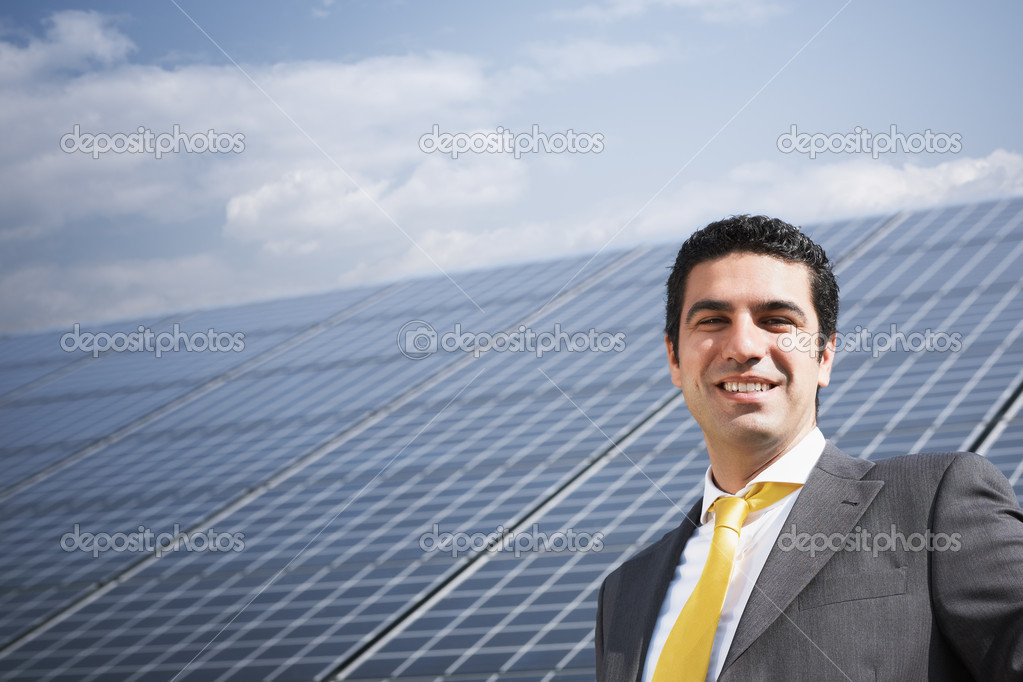 Portrait of mid adult italian businessman in solar power station, smiling at camera. Horizontal shape, front view. Copy space — Stock Photo #9301233