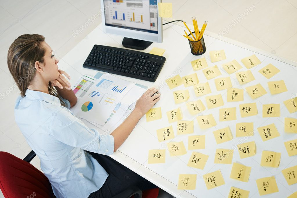 Tired business woman with adhesive notes on table. High angle view — Stock Photo #9302778