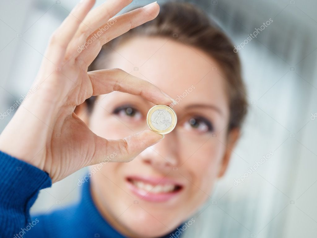 Woman doing ok gesture and showing 1 euro coin. Selective focus — Stock Photo #9302803