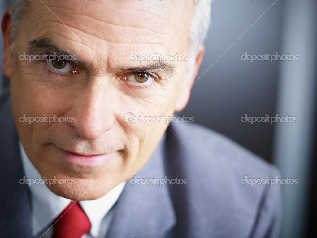 Closeup of mature business man looking at camera. Copy space — Stock Photo #9304649