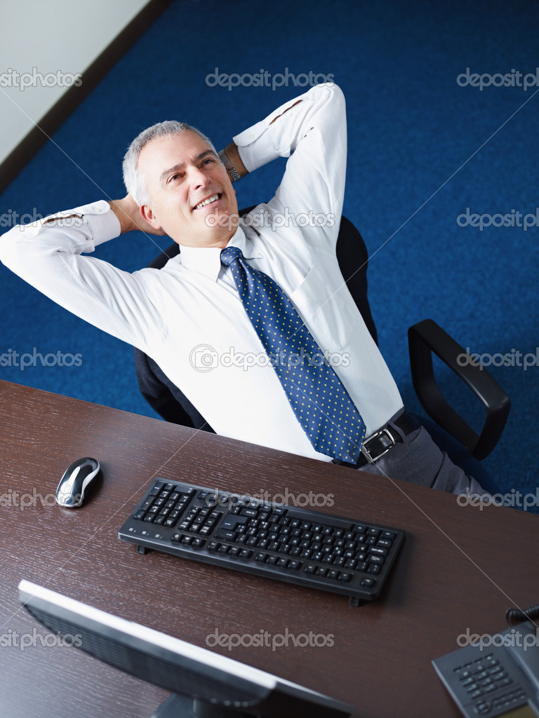Mature business man leaning on chair with hands behind head, looking away and smiling. Copy space — Stock Photo #9304659