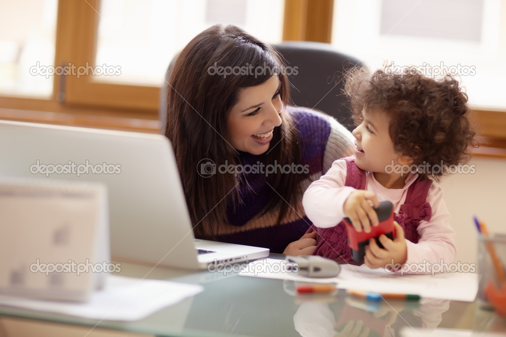 Mom and businesswoman working with laptop computer at home and playing with her baby girl. Horizontal shape, front view, waist up — Stock Photo #9305085
