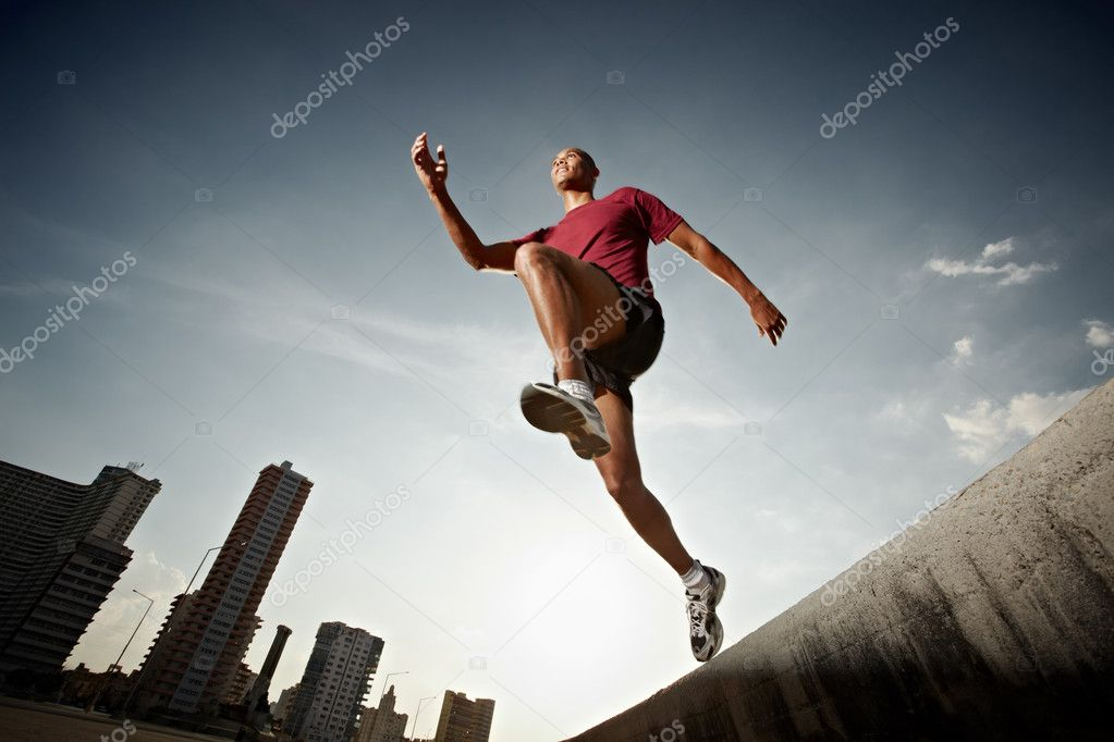 Latin american athlete running in Havana, Cuba. Horizontal shape, full length, low angle view — Stock Photo #9305225