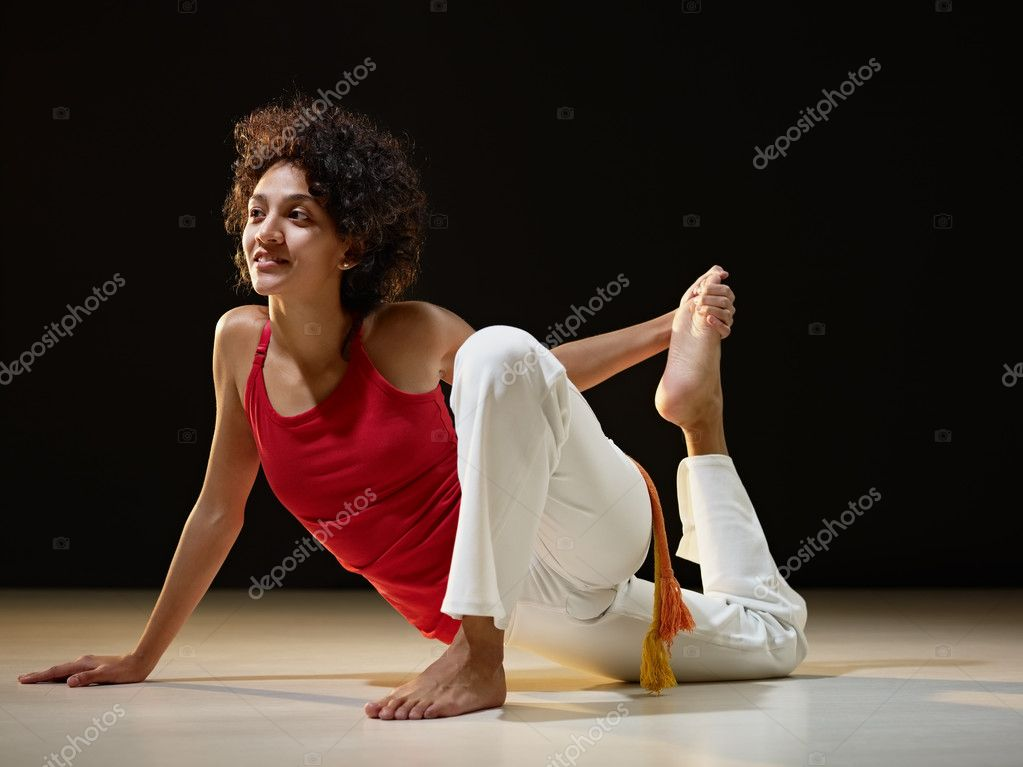 Portrait of young adult latin american female doing yoga exercise in gym. Horizontal shape, full length, side view, copy space — Stock Photo #9306668