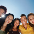 Team of man and women embracing, smiling at camera — Stock Photo