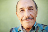 Aged latino man smiling at camera — Stock Photo