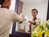 Asian maid working in hotel room and smiling — Stok fotoğraf