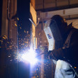 Man at work as welder in heavy industry — Foto Stock