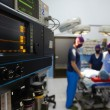 Operation room in clinic with medical staff during surgery - Stockfoto